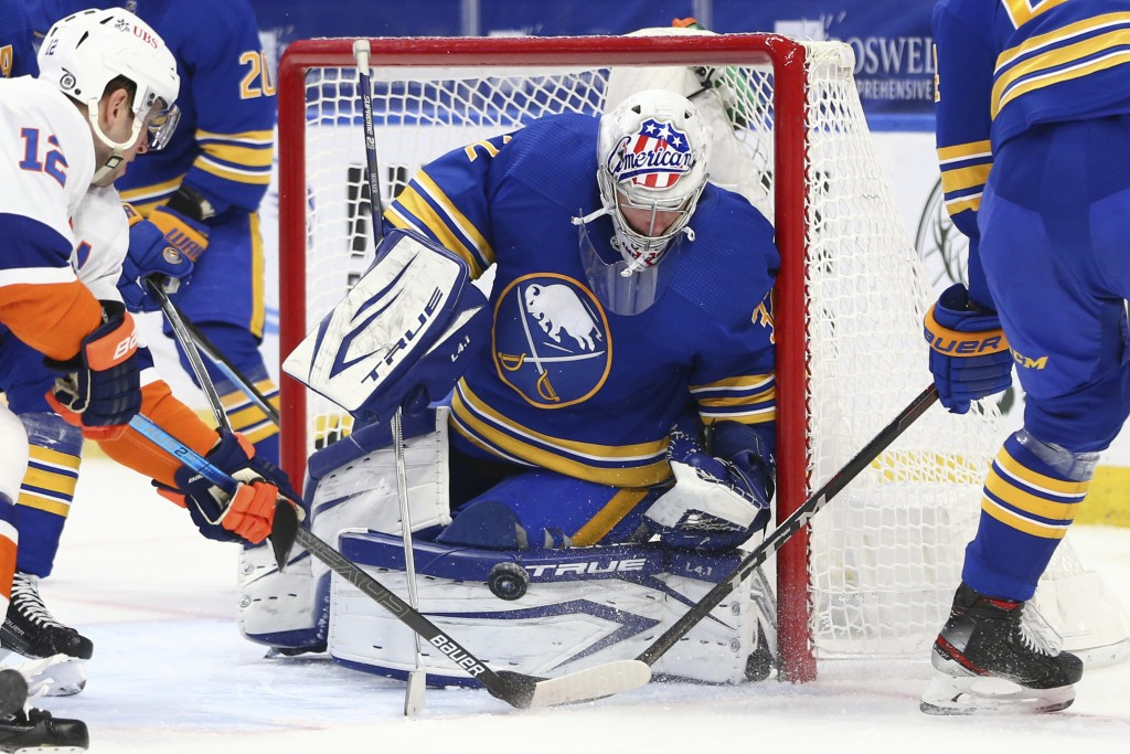 Buffalo Sabres goalie Michael Houser (32) makes a save in traffic during the second period of an NHL hockey game against the New York Islanders, Tuesd...