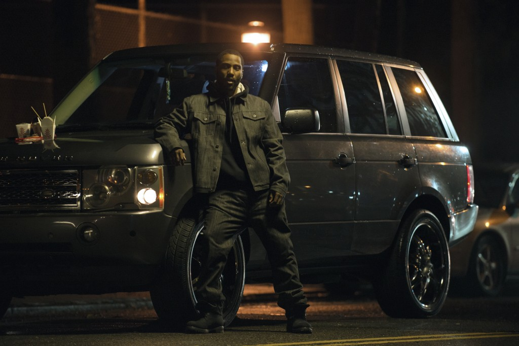 "This image released by Netflix shows John David Washington in a scene from ""Monster."" (Anna Kooris/Netflix via AP)"