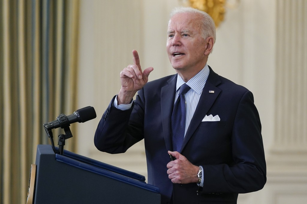 President Joe Biden takes questions from reporters as he speaks about the COVID-19 vaccination program, in the State Dining Room of the White House, T...