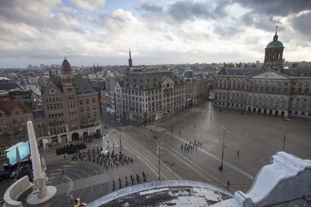 View of Dam Square devoid of spectators due to coronavirus related restrictions, as Dutch King Willem-Alexander and Queen Maxima lay a wreath during a...