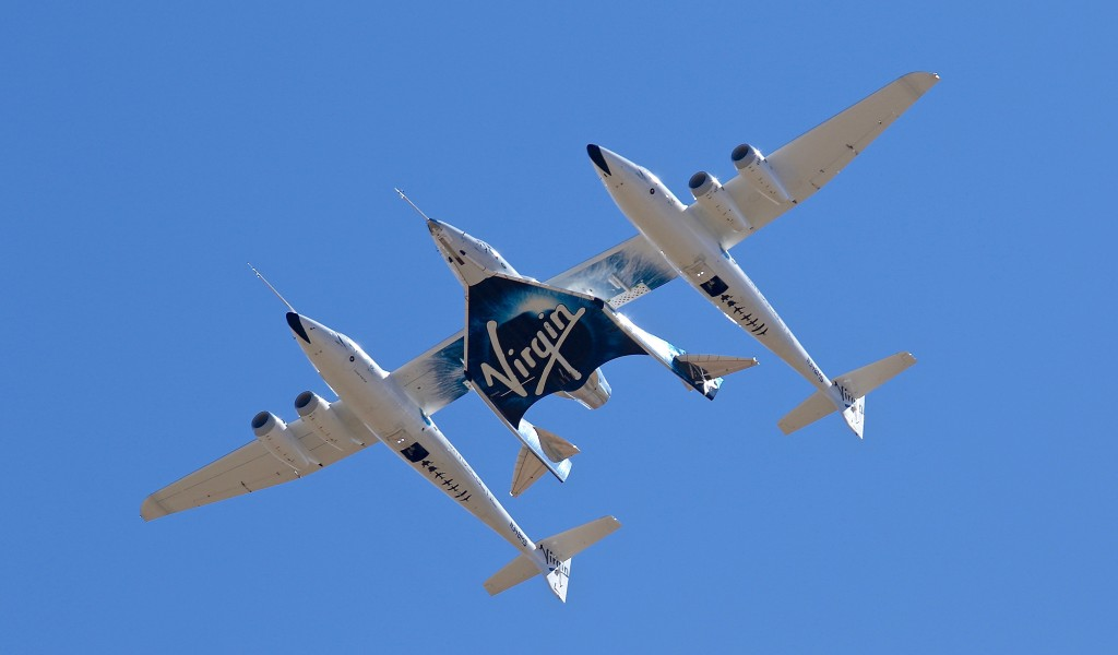 FILE - In this Thursday, Feb. 13, 2020 file photo, Virgin Galactic's VSS Unity departs Mojave Air & Space Port in Mojave, Calif. for the final time as...