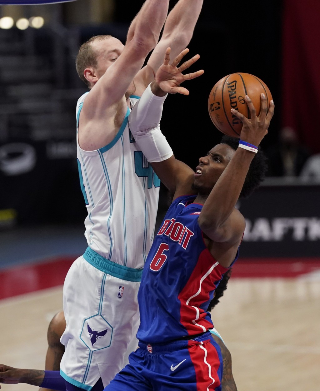 Detroit Pistons guard Hamidou Diallo (6) looks to the basket as Charlotte Hornets center Cody Zeller (40) defends during the second half of an NBA bas...