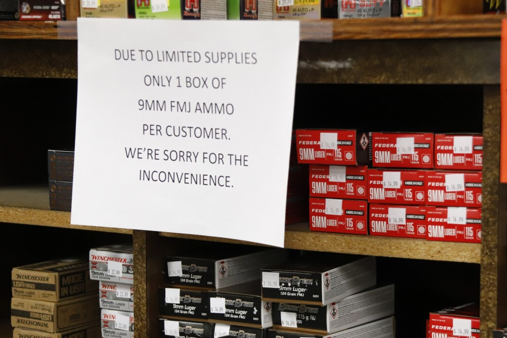 FILE - In this Wednesday, March 25, 2020, file photo, signs point out quantity limits on certain types of ammunition after Dukes Sport Shop reopened, ...