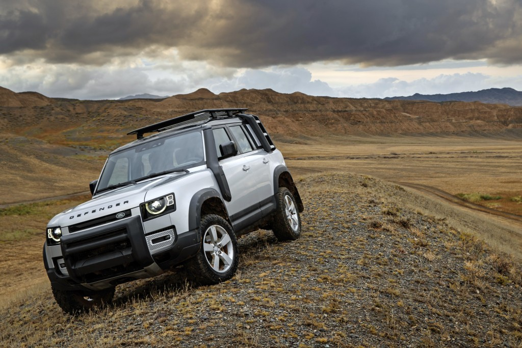 This photo provided by Jaguar Land Rover Ltd. shows the 2021 Land Rover Defender. The Defender combines luxury and off-road capability in the same sle...