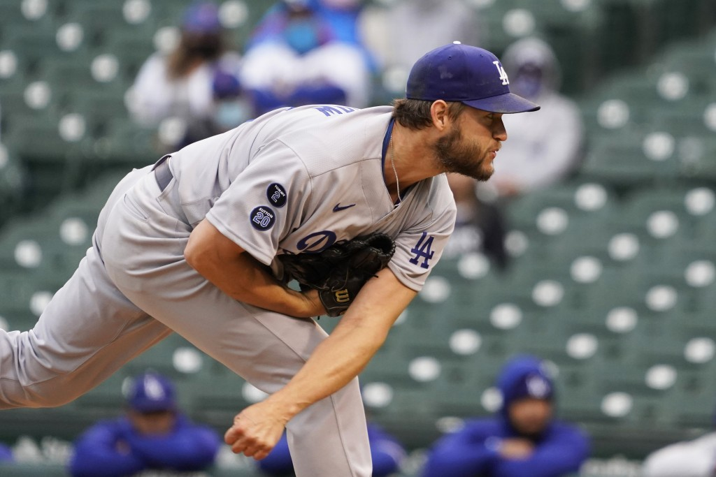 Los Angeles Dodgers starting pitcher Clayton Kershaw throws the ball against the Chicago Cubs during the first inning of the first baseball game of a ...