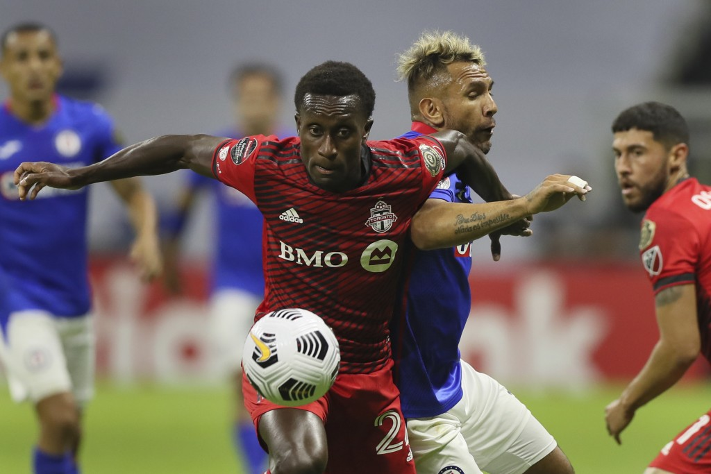 Richie Laryea of Canada's Toronto FC, front, and Walter Montoya of Mexico's Cruz Azul compete for the ball during CONCACAF Champions League quarterfin...