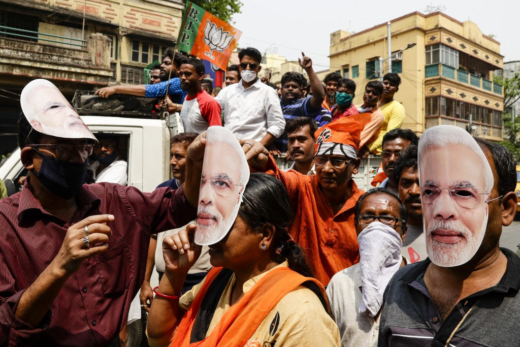FILE - In this March 20, 2021, file photo, supporters of Bharatiya Janata Party wearing masks bearing the likeness of Prime Minister Narendra Modi par...