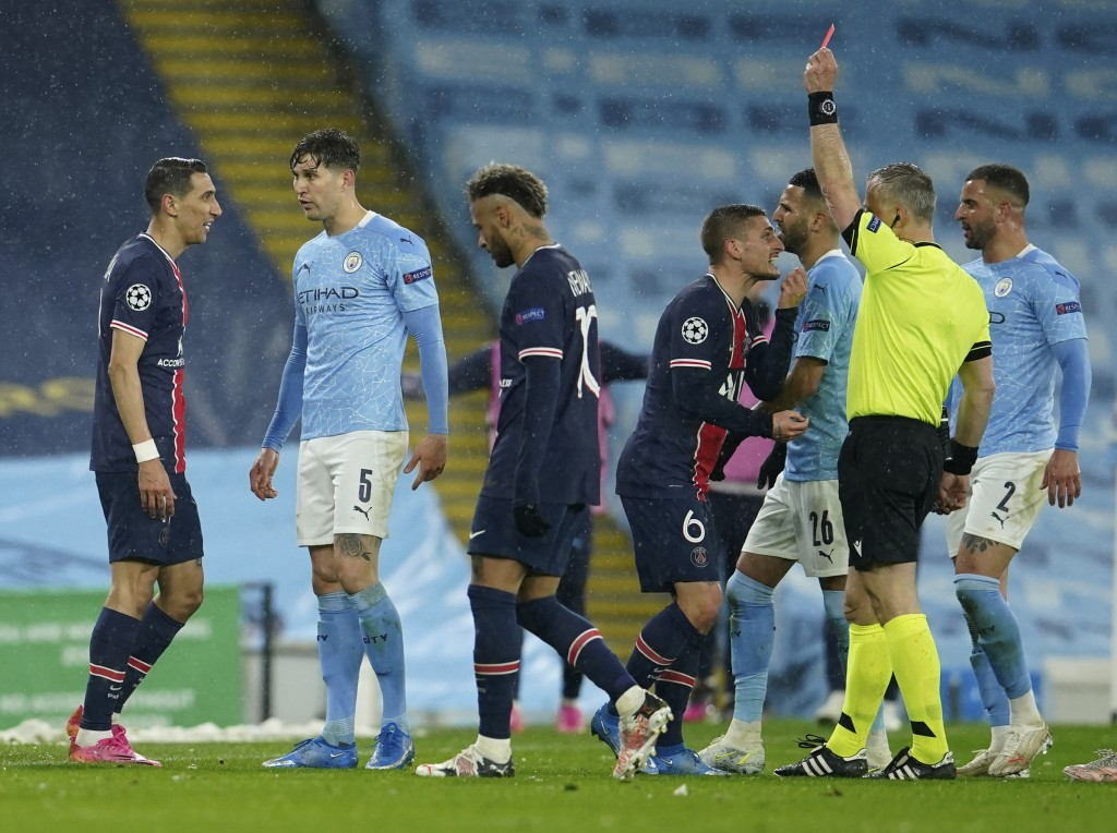 PSG's Angel Di Maria, left, sees a red card during the Champions League semifinal second leg soccer match between Manchester City and Paris Saint Germ...