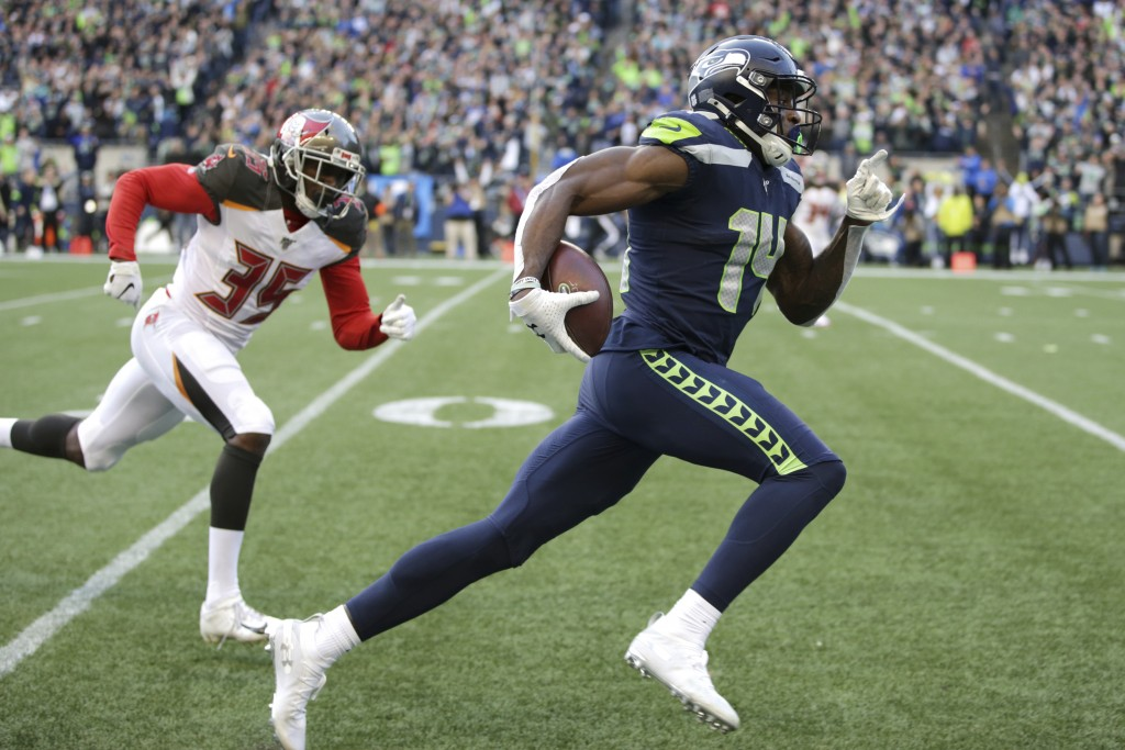 FILE - Seattle Seahawks wide receiver DK Metcalf, right, runs to score a touchdown ahead of Tampa Bay Buccaneers defensive back Jamel Dean during the ...