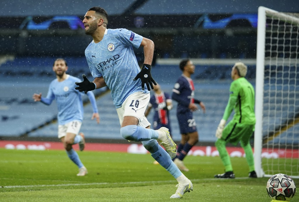 Manchester City's Riyad Mahrez celebrates after scoring his sides second goal during the Champions League semifinal second leg soccer match between Ma...