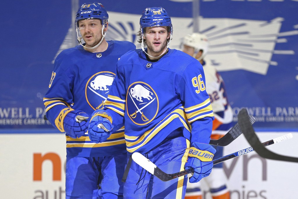 Buffalo Sabres forward Anders Bjork (96) celebrates his goal with forward Sam Reinhart (23) during the third period of an NHL hockey game against the ...