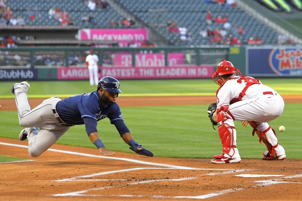 ADDS THAT MARGOT SCORES ON A FIELDING ERROR AND A SINGLE - Tampa Bay Rays' Manuel Margot, left, scores after a single by Brandon Lowe and a fielding e...