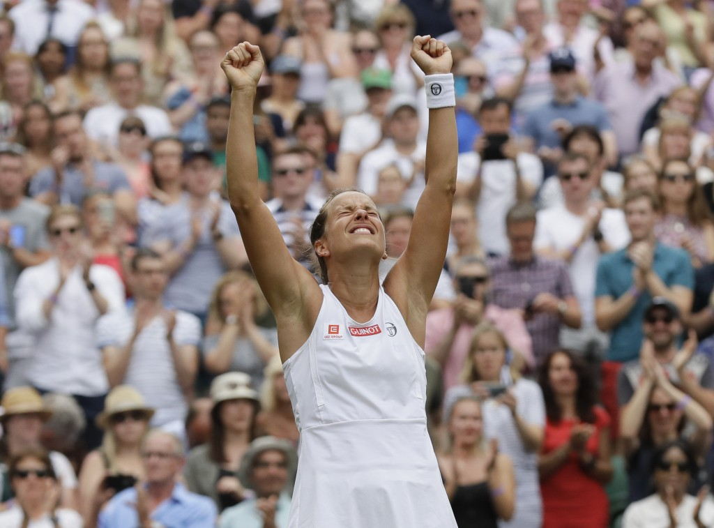 FILE - In this file photo taken on Tuesday July 9, 2019, Czech Republic's Barbora Strycova celebrates winning a women's quarterfinal match against Bri...
