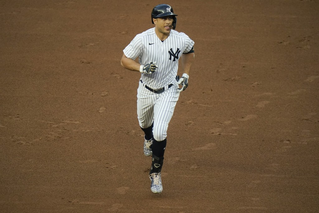 New York Yankees' Giancarlo Stanton runs the bases after hitting a two-run home run during the first inning of a baseball game against the Houston Ast...