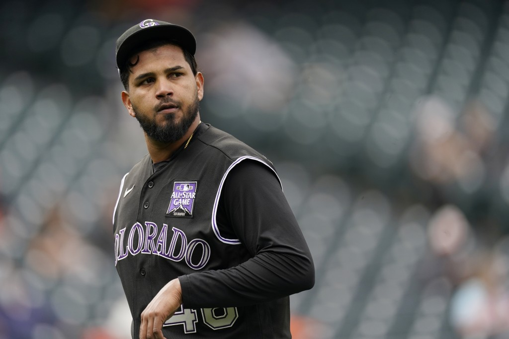 Colorado Rockies starting pitcher German Marquez checks the scoreboard as he heads to the dugout after being pulled form the mound following his walk ...