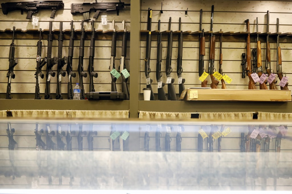 Guns are displayed in the showroom of Maxon Shooter's Supplies and Indoor Range, Friday, April 30, 2021, in Des Plaines, Ill. After a year of pandemic...