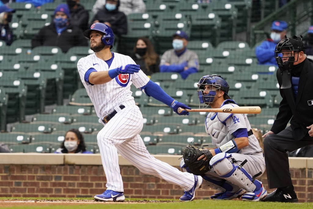 Chicago Cubs' David Bote hits a three run double against the Los Angeles Dodgers during the first inning of the first baseball game of a doubleheader ...