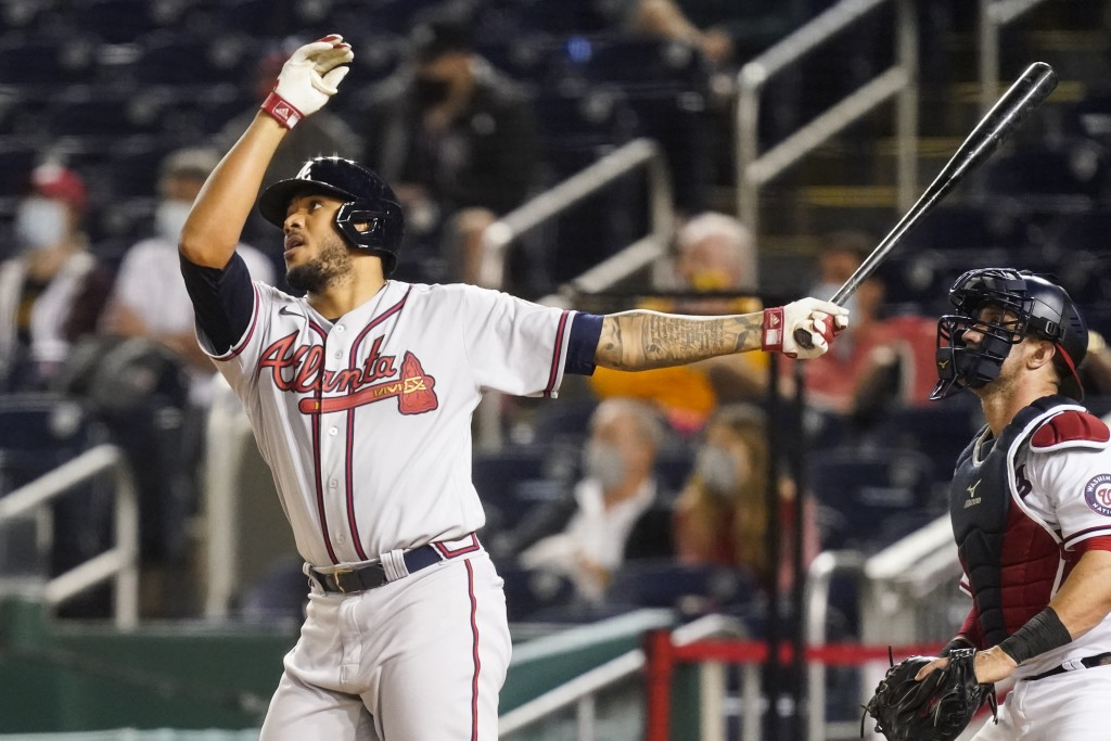 Atlanta Braves' Huascar Ynoa watches his grand slam during the sixth inning of baseball game against the Washington Nationals at Nationals Park, Tuesd...