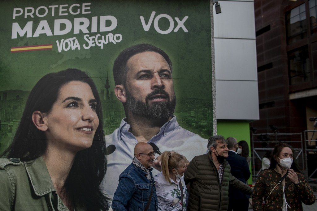 People gather outside the Vox party headquarters in Madrid, Spain, Tuesday, May 4, 2021. Madrid residents voted in droves for a new regional assembly ...