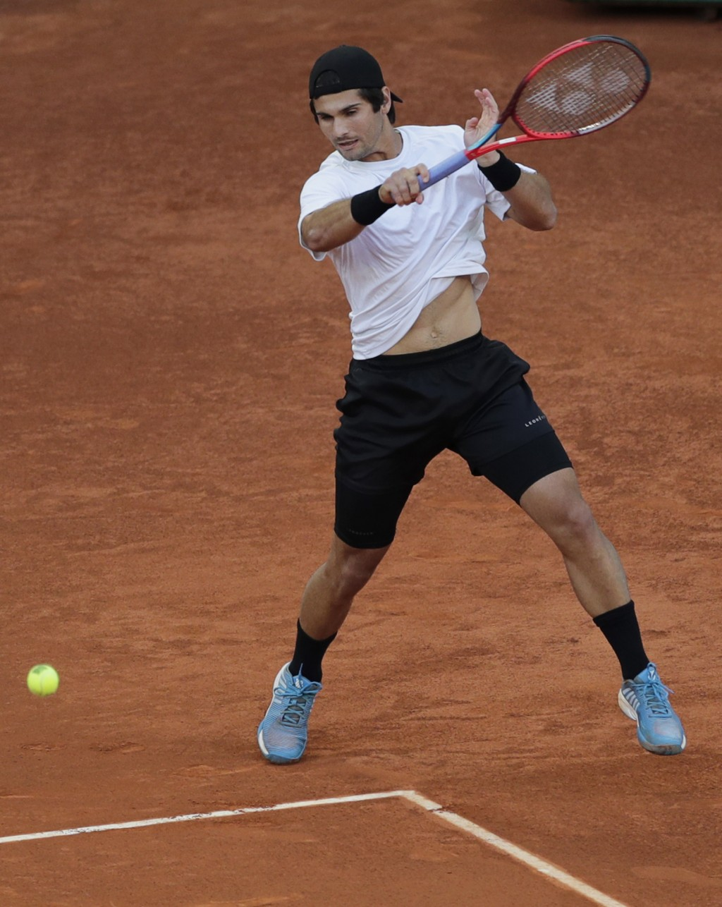 Marcos Giron of the U.S. returns the ball to Dominic Thiem of Austria during their match at the Madrid Open tennis tournament in Madrid, Spain, Tuesda...