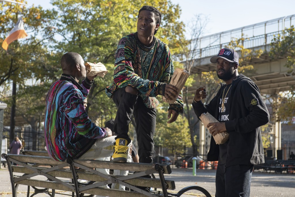 """This image released by Netflix shows A$AP Rock, center, in a scene from """"Monster."""" (David Giesbrecht/Netflix via AP)"""