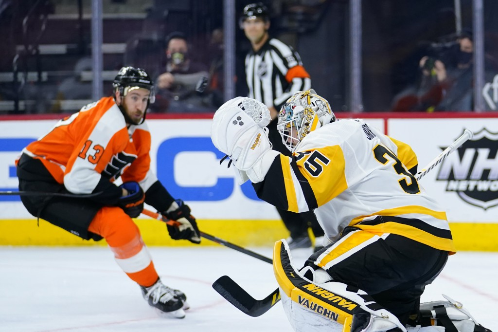 Pittsburgh Penguins' Tristan Jarry, right, blocks a shot as Philadelphia Flyers' Kevin Hayes looks on during the third period of an NHL hockey game, T...