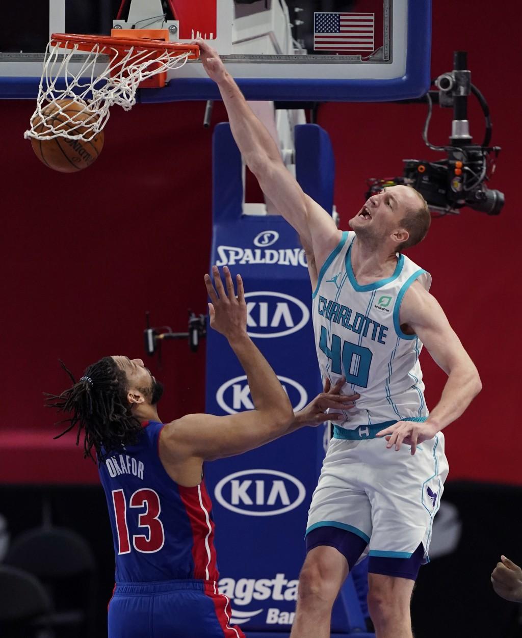 Charlotte Hornets center Cody Zeller (40) dunks on Detroit Pistons center Jahlil Okafor (13) during the second half of an NBA basketball game, Tuesday...