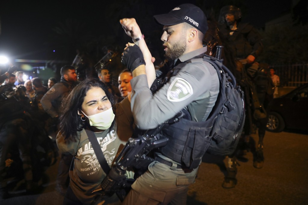 A Palestinian woman scuffles with Israeli border police officer during a protest against the planned evictions of Palestinian families in the Sheikh J...