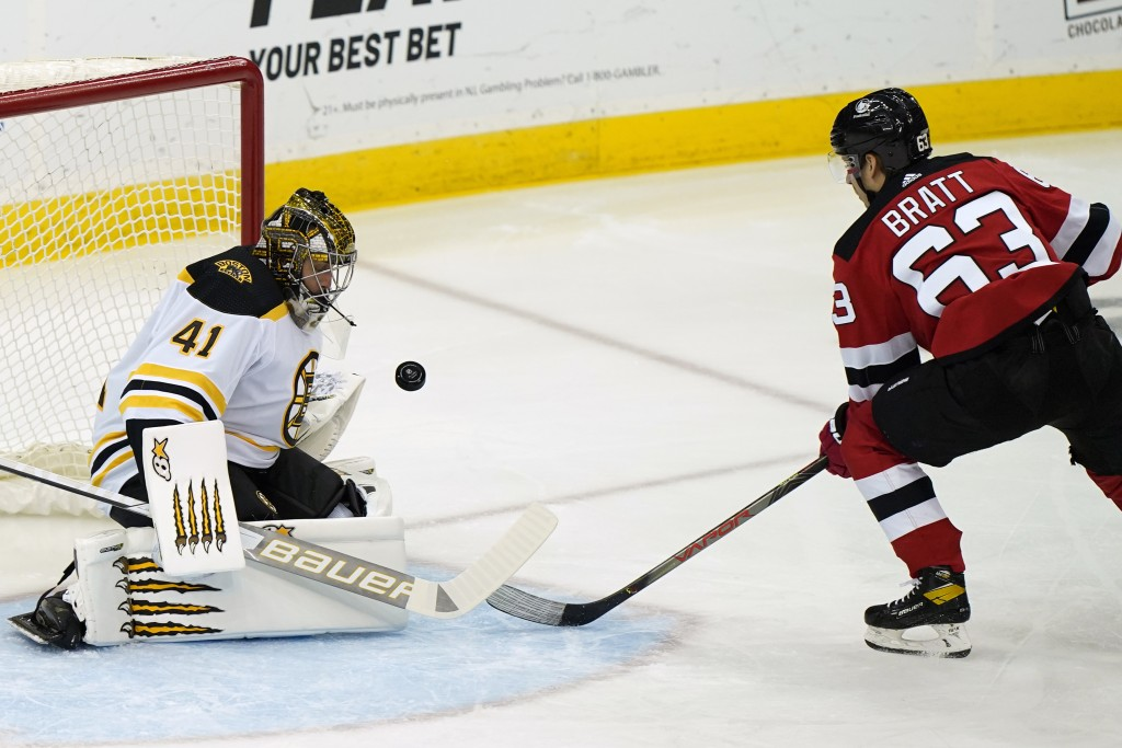 Boston Bruins goaltender Jaroslav Halak (41) makes a save on a shot by New Jersey Devils left wing Jesper Bratt (63) during the first period of an NHL...