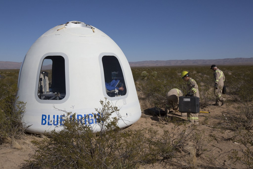 FILE - This Tuesday, Dec. 12, 2017 photo provided by Blue Origin shows the New Shepard Crew Capsule 2.0 after landing in west Texas during a test. Nam...
