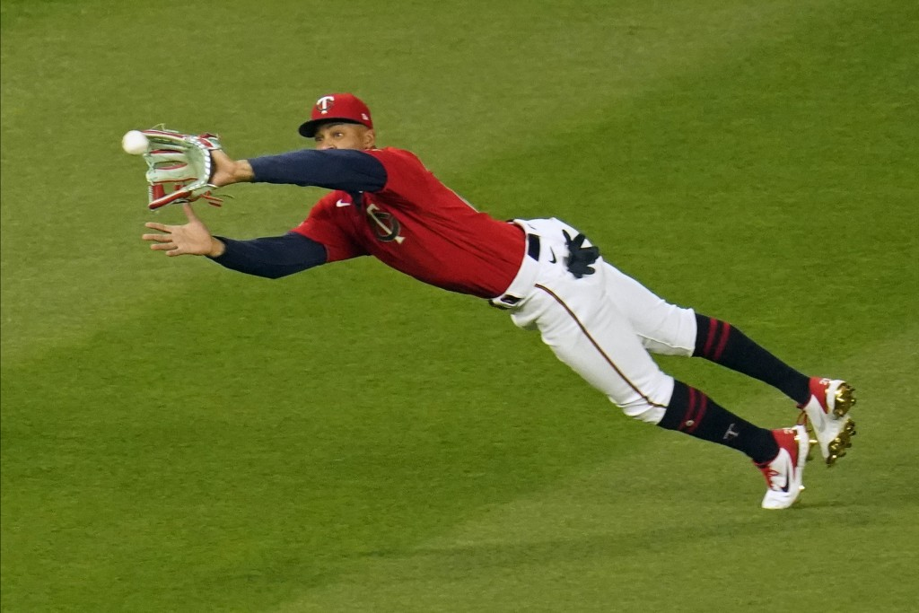 Minnesota Twins center fielder Byron Buxton makes a diving catch of a fly ball off the bat of Texas Rangers' David Dahl in the seventh inning of a bas...