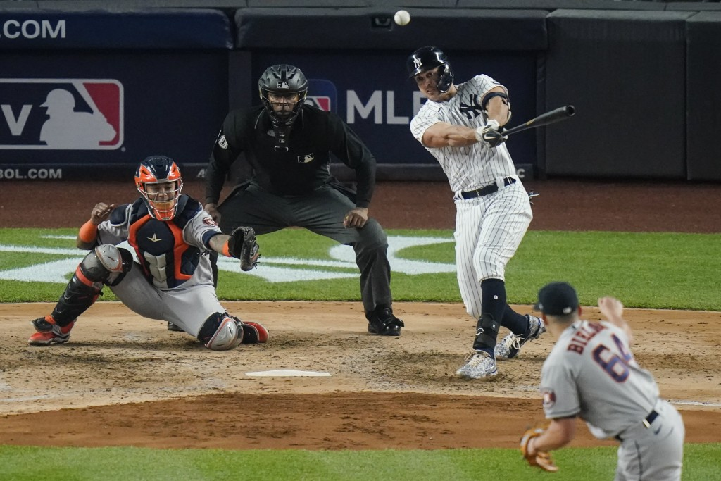 New York Yankees' Giancarlo Stanton follows through on a double during the fifth inning of a baseball game against the Houston Astros Tuesday, May 4, ...