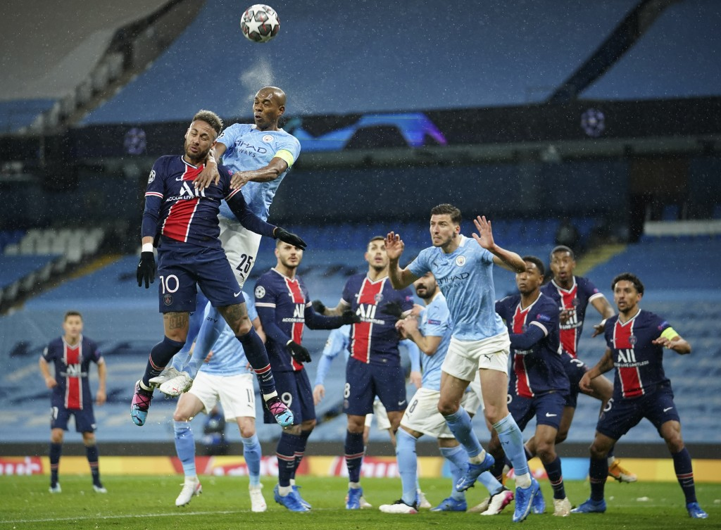 PSG's Neymar, left, challenges Manchester City's Fernandinho during the Champions League semifinal second leg soccer match between Manchester City and...