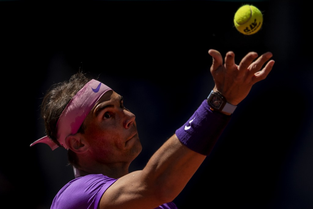 Spain's Rafael Nadal serves to Spain's Carlos Alcaraz during their match at the Mutua Madrid Open tennis tournament in Madrid, Spain, Wednesday, May 5...