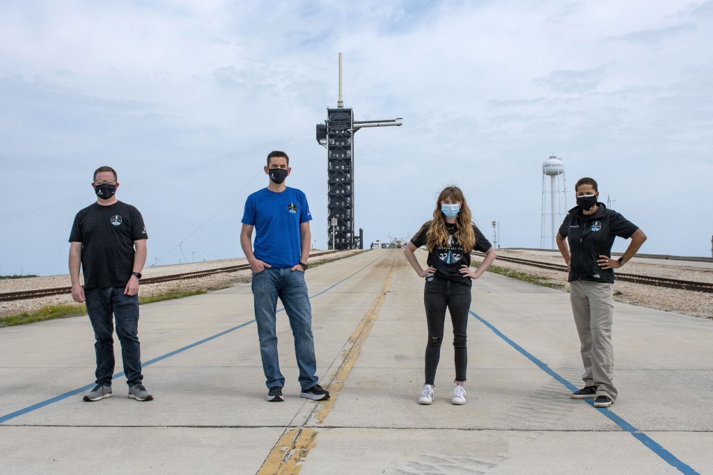 FILE - In this photo provided by SpaceX, Chris Sembroski, from left to right, Jared Isaacman, Hayley Arceneaux and Sian Proctor pose for a photo, Mond...