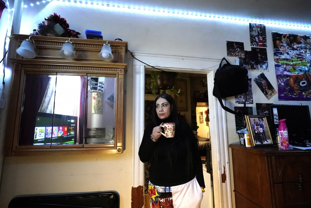 FILE- In this March 10, 2021, file photo, Isabel Miranda drinks coffee in her rental apartment where she lives with her partner and two sons, in Haver...