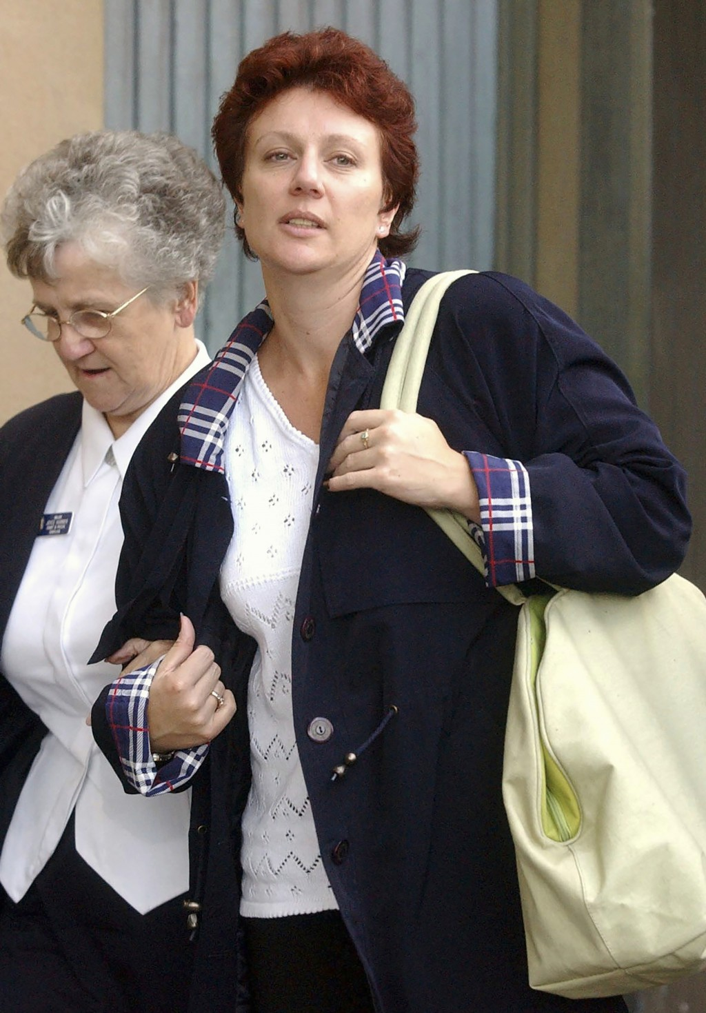 Kathleen Folbigg, right, leaves the Supreme Court in Sydney on April 3, 2003. Nearly two decades after Folbigg was convicted of killing her four child...