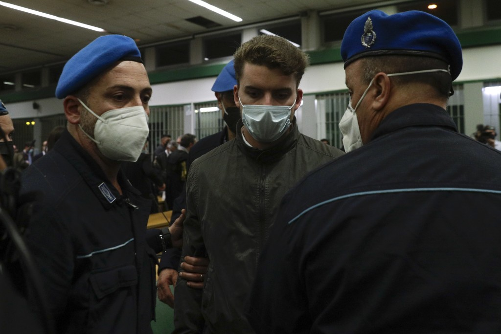 Gabriel Natale-Hjorth is escorted by police officers during the trial for the slaying of an Italian plainclothes police officer in Rome in summer 2019...