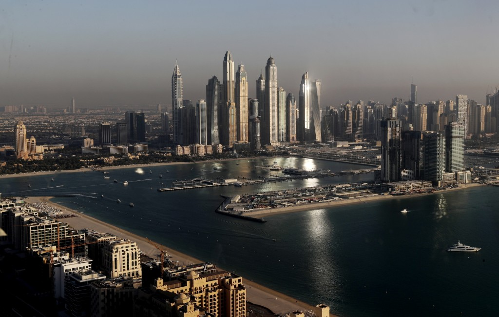 Luxury towers dominate the skyline in the Marina district, center, and the new Dubai Harbour development, right, are seen from the observation deck of...