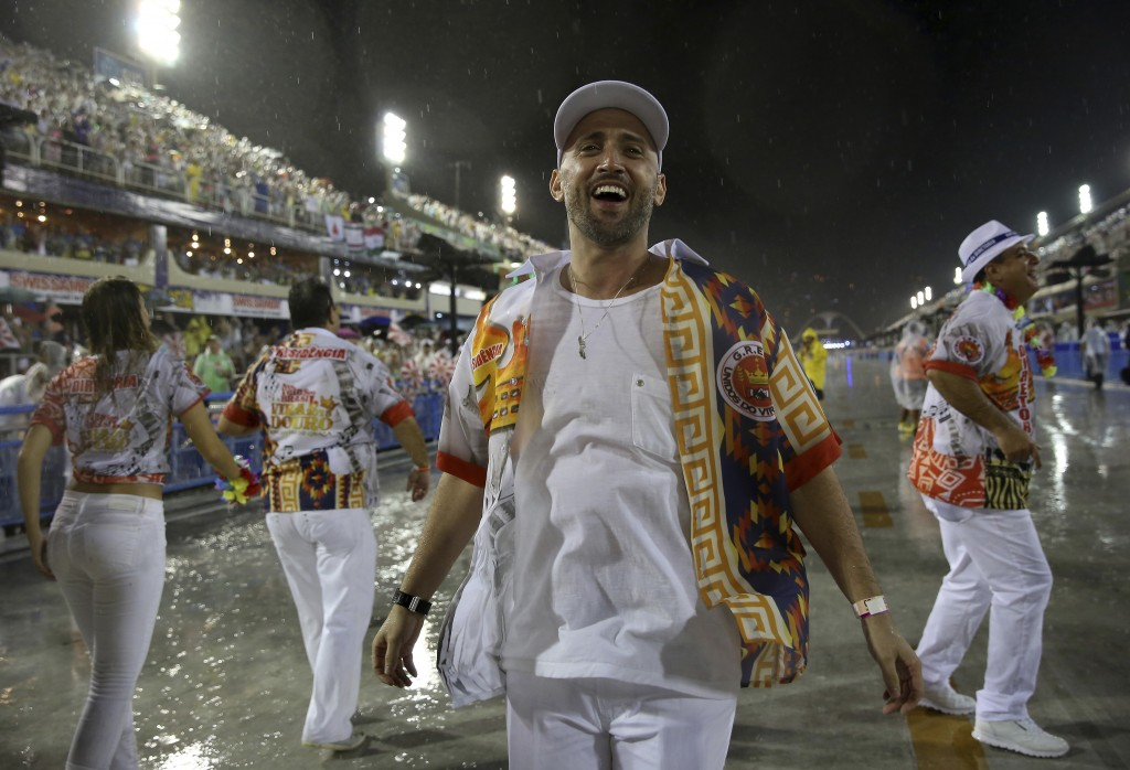 In this Feb. 15, 2015 photo, comedian and actor Paulo Gustavo participates in the Carnival parade at the Sambadrome in Rio de Janeiro, Brazil. The pop...
