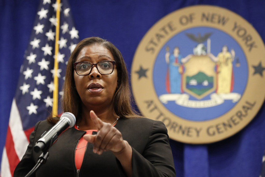 FILE- In this Aug. 6, 2020 file photo, New York State Attorney General Letitia James takes a question at a news conference in New York.  The Office of...