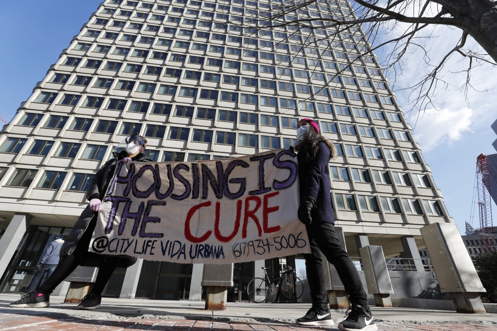 FILE - In this Jan. 13, 2021, file photo tenants' rights advocates demonstrate outside the JFK federal building in Boston. The protest was part of a n...