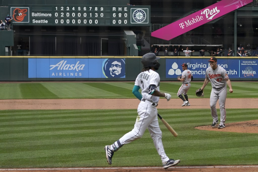 Baltimore Orioles starting pitcher John Means, right, starts to celebrate after Seattle Mariners' J.P. Crawford, foreground, lined out for the final o...