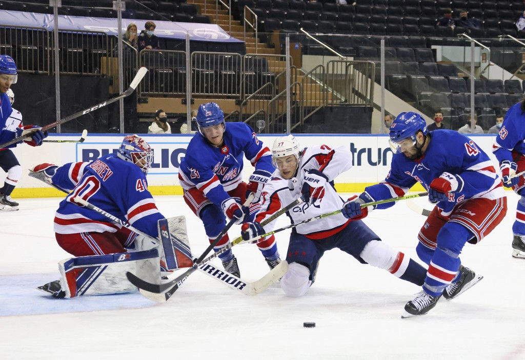 Washington Capitals' T.J. Oshie (77) is thwarted by the New York Rangers defense during the third period of an NHL hockey game Wednesday, May 5, 2021,...