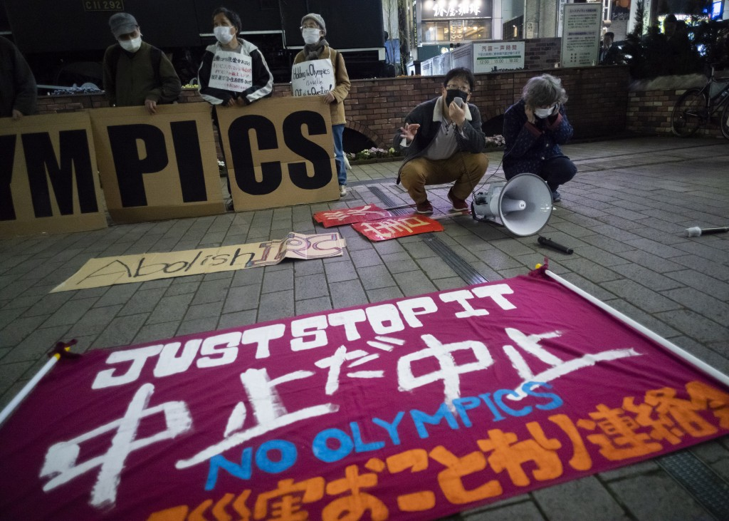 """FILE - In this March 25, 2021, file photo, a """"No Olympics"""" banner is placed by protesters in Tokyo during a demonstration against the going ahead of t..."""