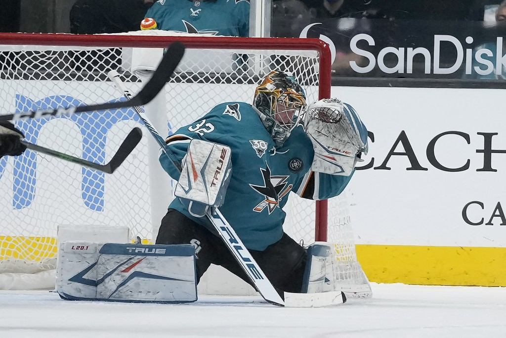 San Jose Sharks goaltender Josef Korenar (32) blocks a shot against the Colorado Avalanche during the first period of a hockey game in San Jose, Calif...