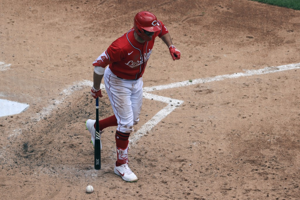 Cincinnati Reds' Joey Votto reacts after being hit by a pitch during the fourth inning of a baseball game against the Chicago White Sox in Cincinnati,...
