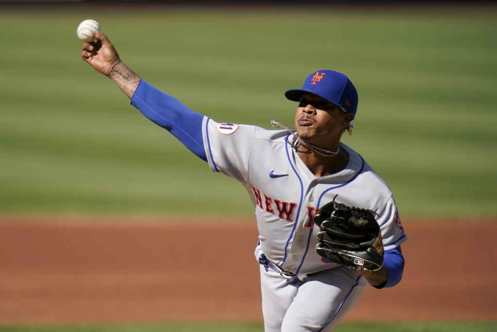 New York Mets starting pitcher Marcus Stroman throws during the first inning in the first game of a baseball doubleheader against the St. Louis Cardin...