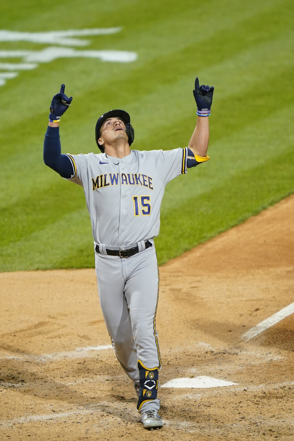 Milwaukee Brewers' Tyrone Taylor reacts after hitting a home run off Philadelphia Phillies pitcher Chase Anderson during the fifth inning of baseball ...