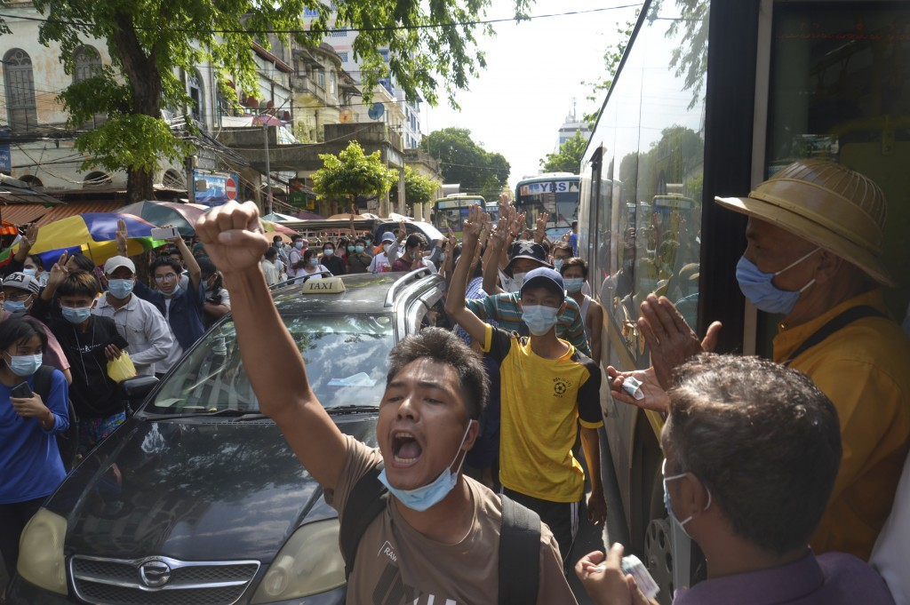 Anti-coup protesters shout slogans during a demonstration on Thursday, May 6, 2021, in Yangon, Myanmar. More than 200 global organizations urged the U...
